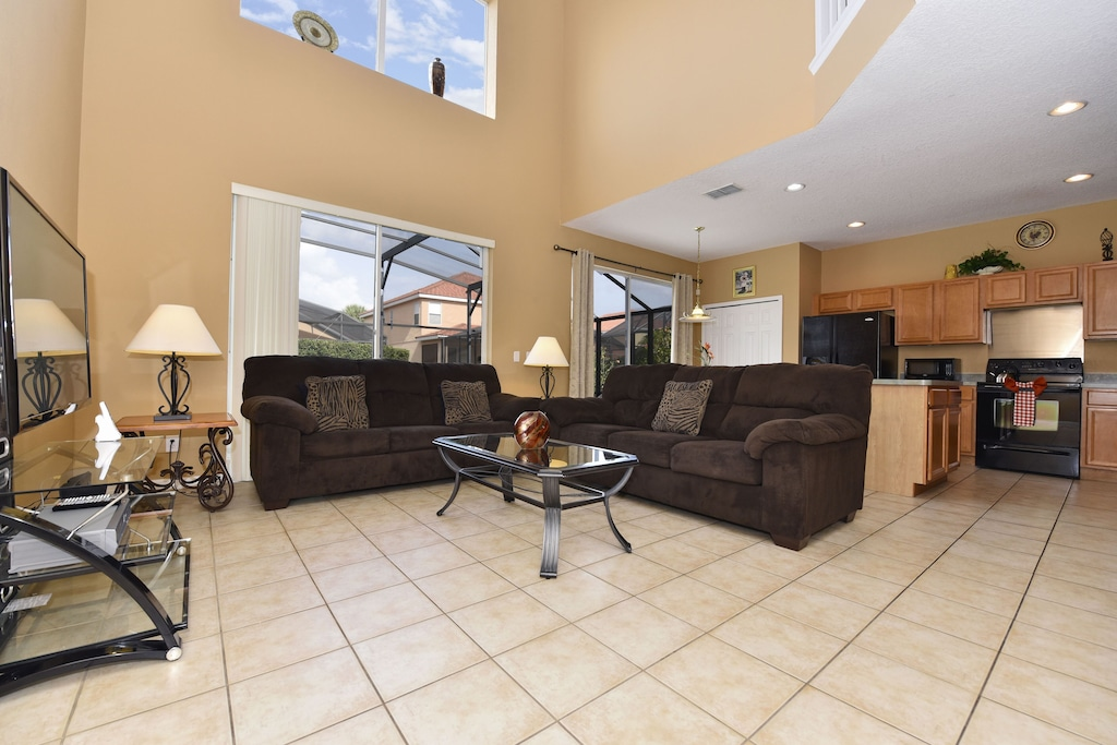 Large open family room with view of the pool/Spa