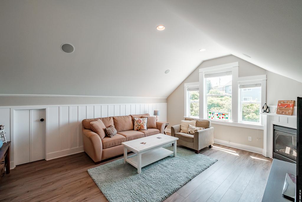Bonus ocean view upper media room with fireplace and queen sleeper sofa.