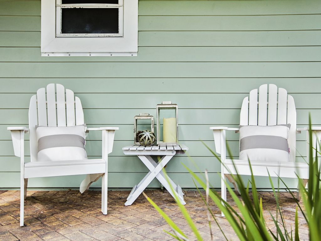 Relax on our front porch adirondack chairs with a nice book.