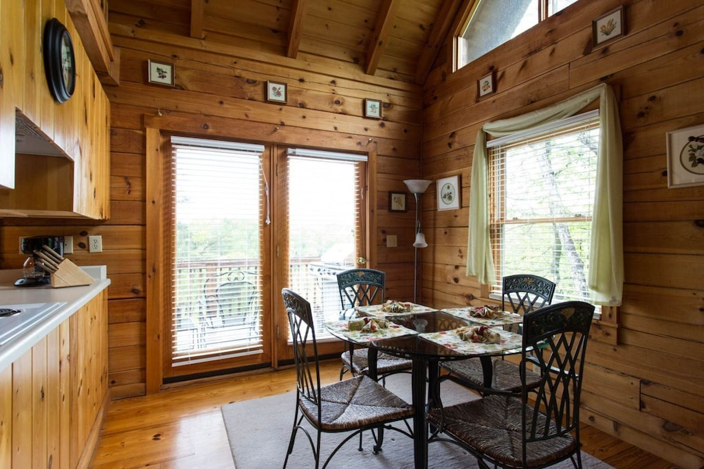 Just beyond the living area is the dining table with seating for 4.