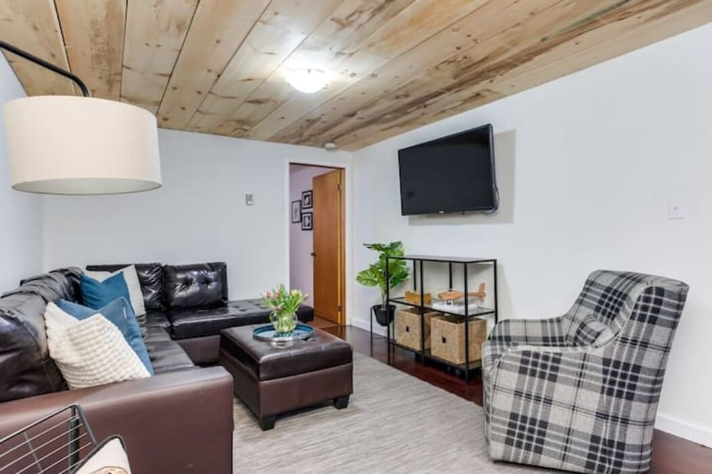 TV room in recreation area with smart TV. 5th bedroom at the end of this room.