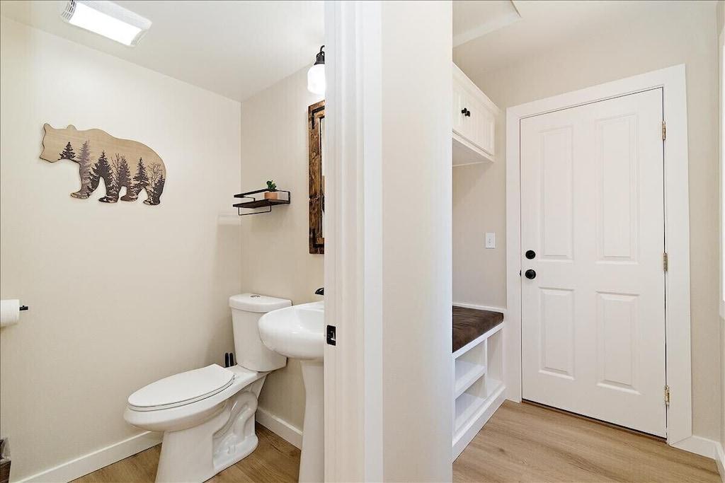 Half bathroom located next to mudroom and garage entrance.