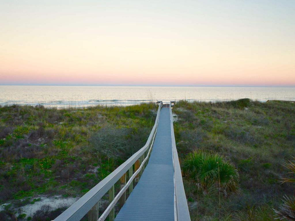 Over the dunes to the beach. Please don't touch or feed the gopher turtles!