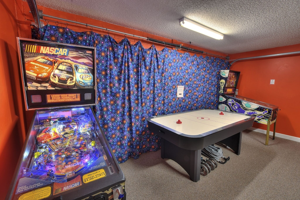 Nascar pinball machine and air hockey.