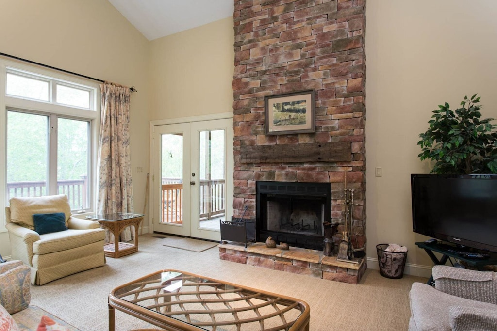 The focal point of the living area is the beautiful fireplace with stones that rise to the ceiling.
