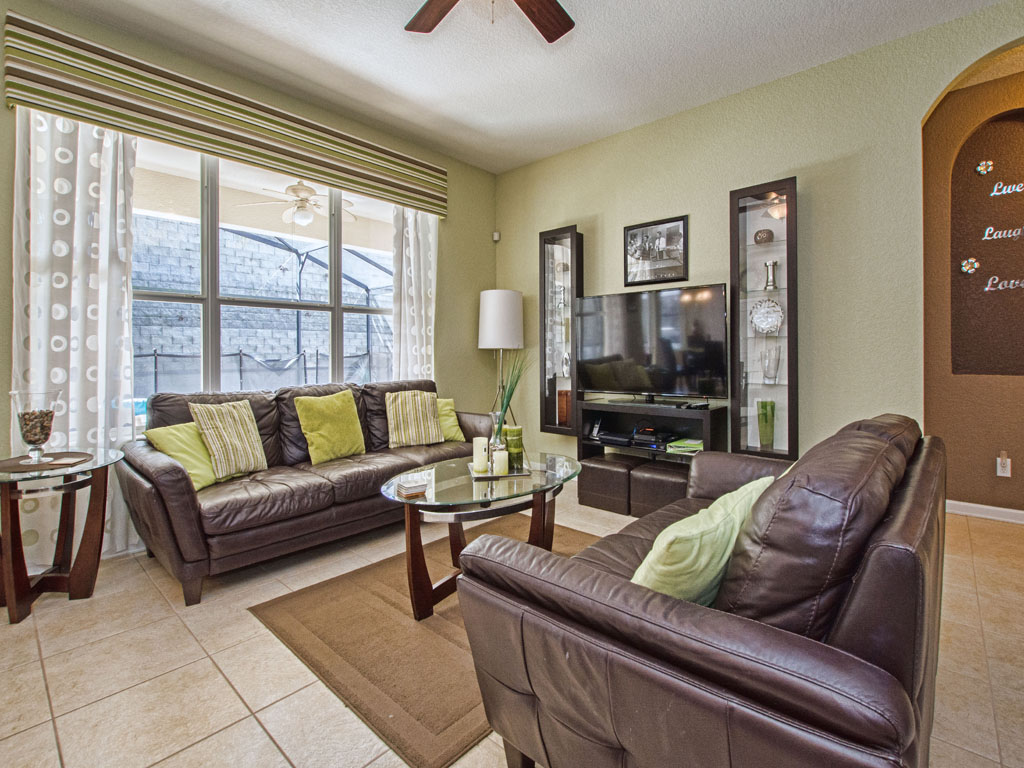Living room features a 65 in Roku TV and view of the pool.