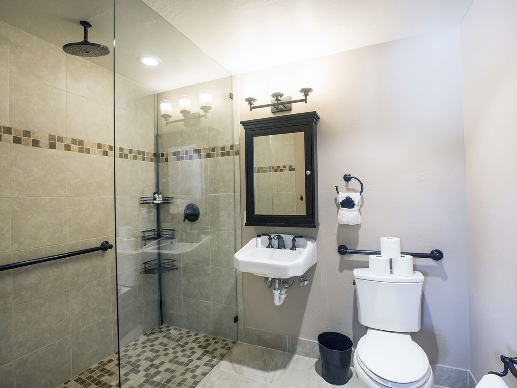 Master bath Bedroom #2 - Private bath for bedroom #2.  Shower with rain forest style shower head.