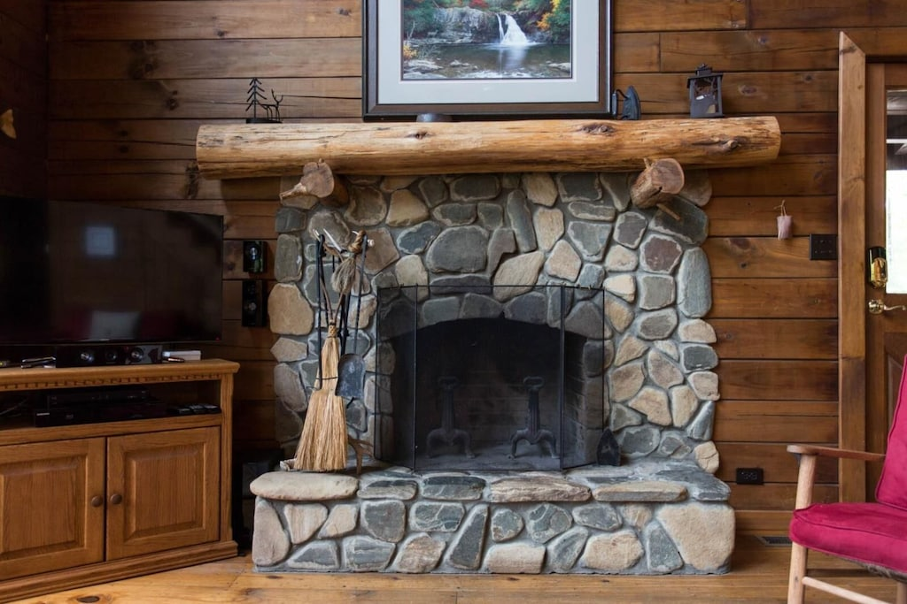 The wood-burning stone fireplace is the focal point of this area.