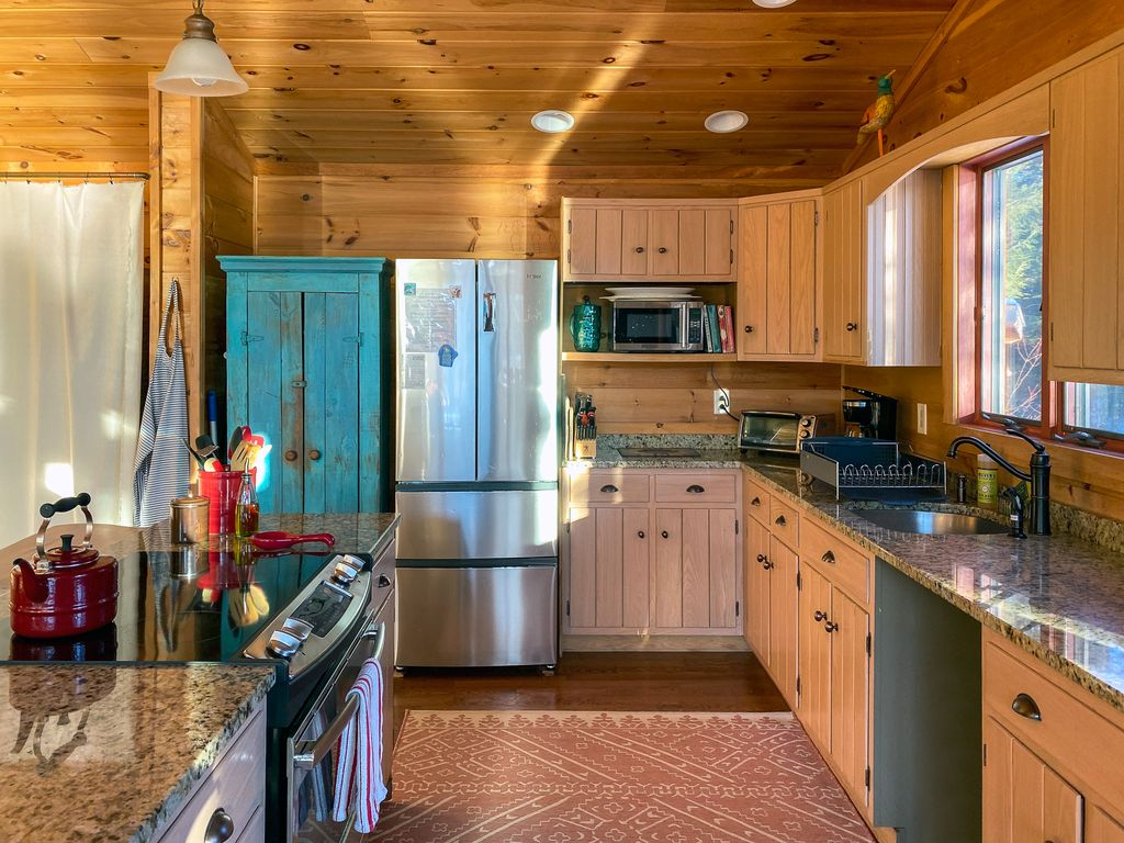 Stainless Steel Appliances in Rich Pine Woods