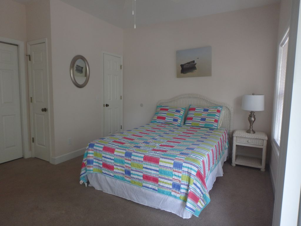 Firstt floor bedroom with queen bed, private bath and deck access