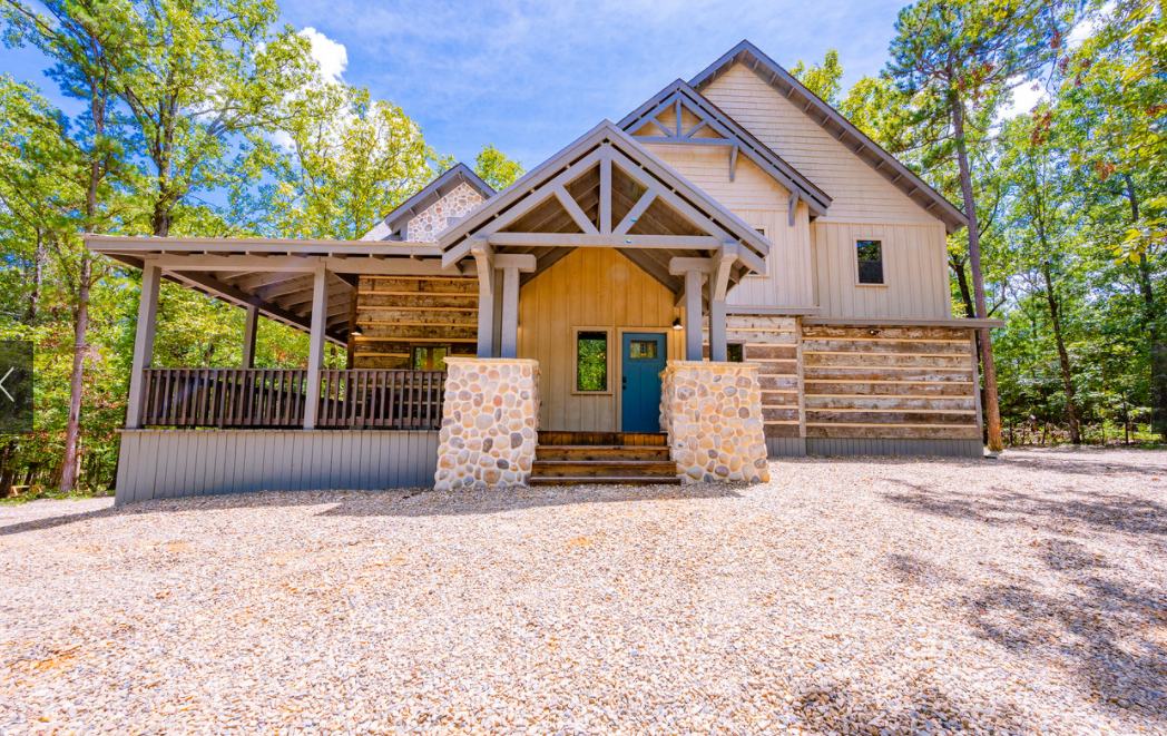 Exterior wrapped in 100 year old barn wood and oversized front and back porch makes Mustang Sally on the of the charming cabins in the area