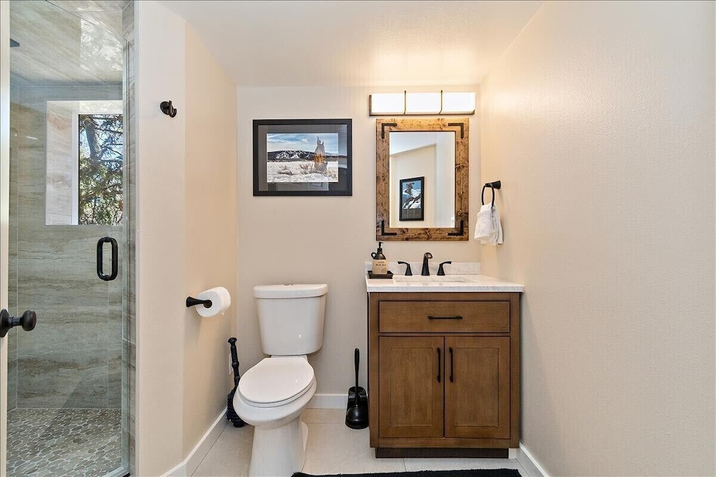 Brand new full bath located next to game room w/ Rain-shower features.