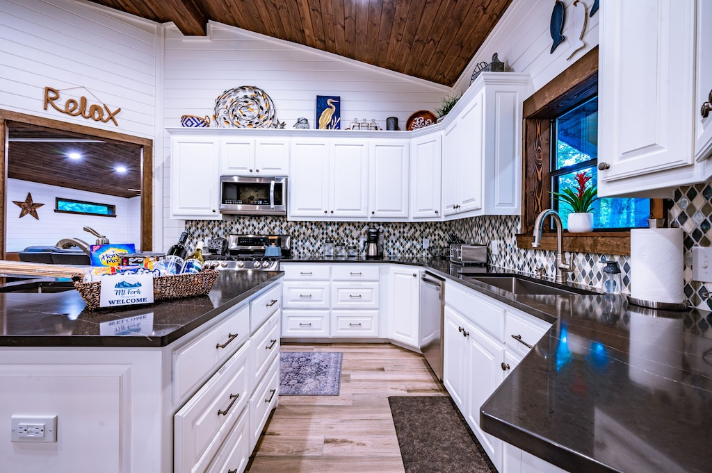 Fully stocked, top of the line open concept kitchen.