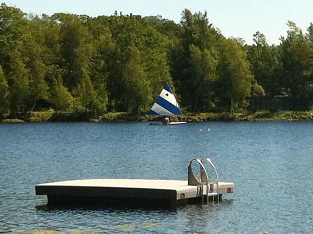 Swim platform with ladder to climb on!  Fun for all and sun bathing!