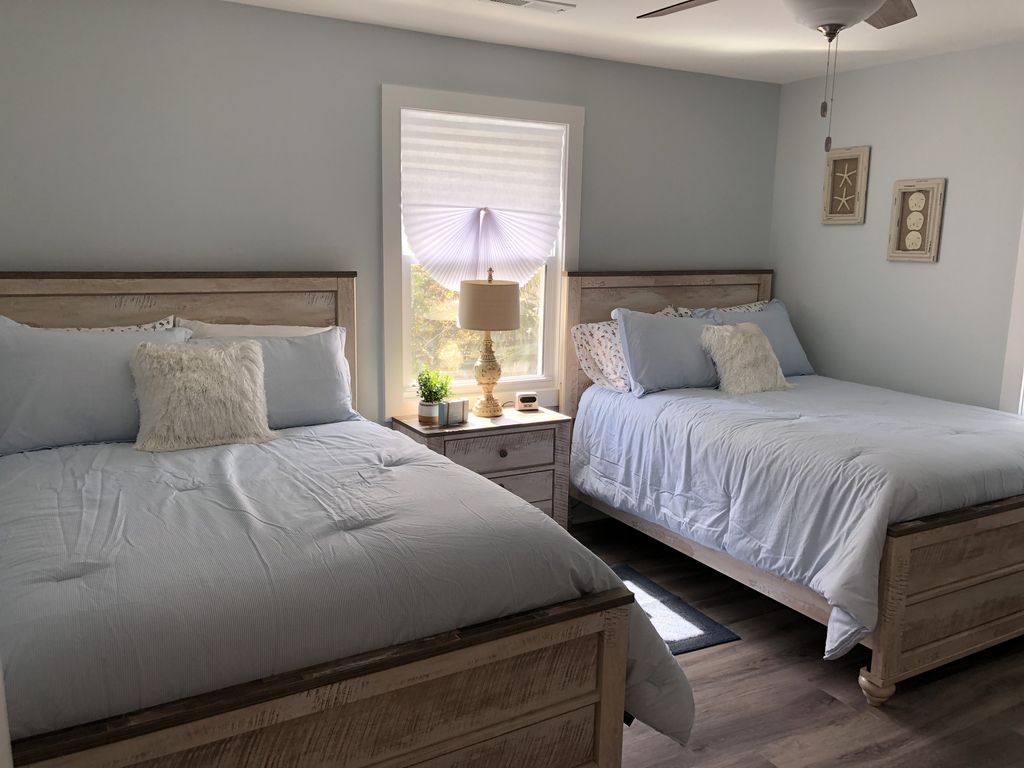 Bedroom with two full beds located on second floor