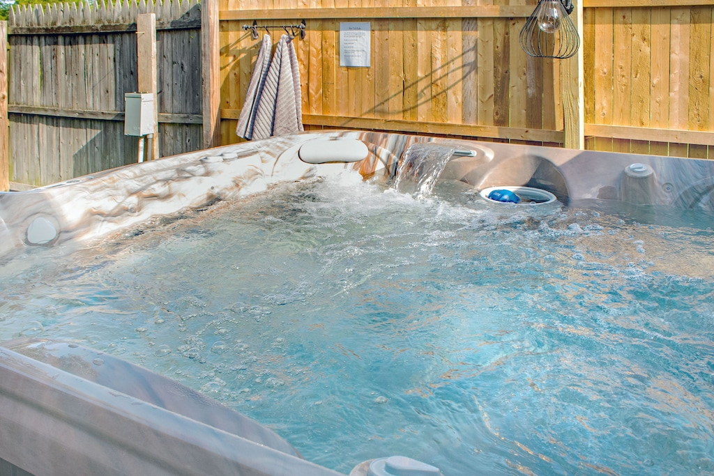 Private hot tub in fenced back yard