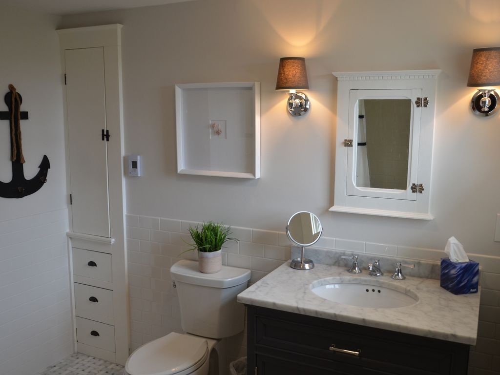 2nd floor bathroom vanity with original built-ins.