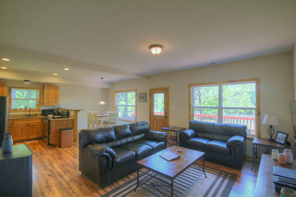 Open floor plan with kitchen area flowing into the living room