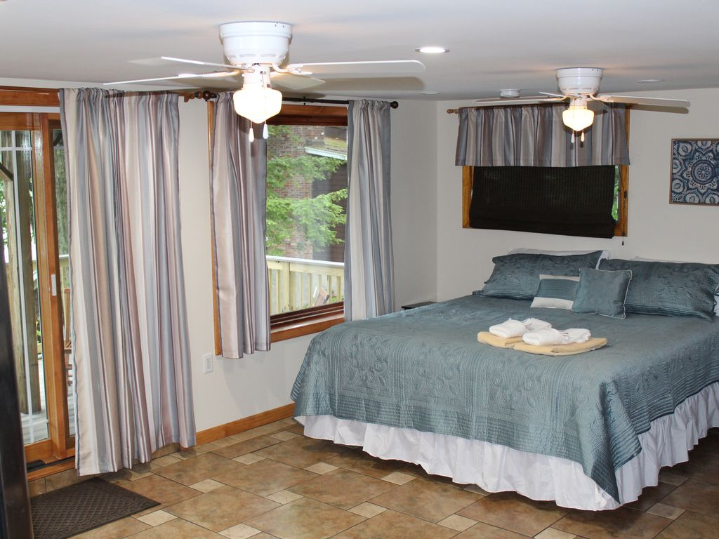 King Bedroom with deck overlooking the lake
