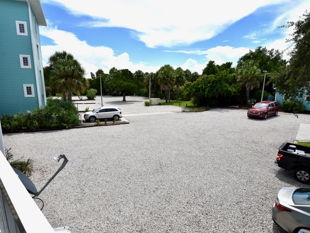 Gravel lot with parking available throughout