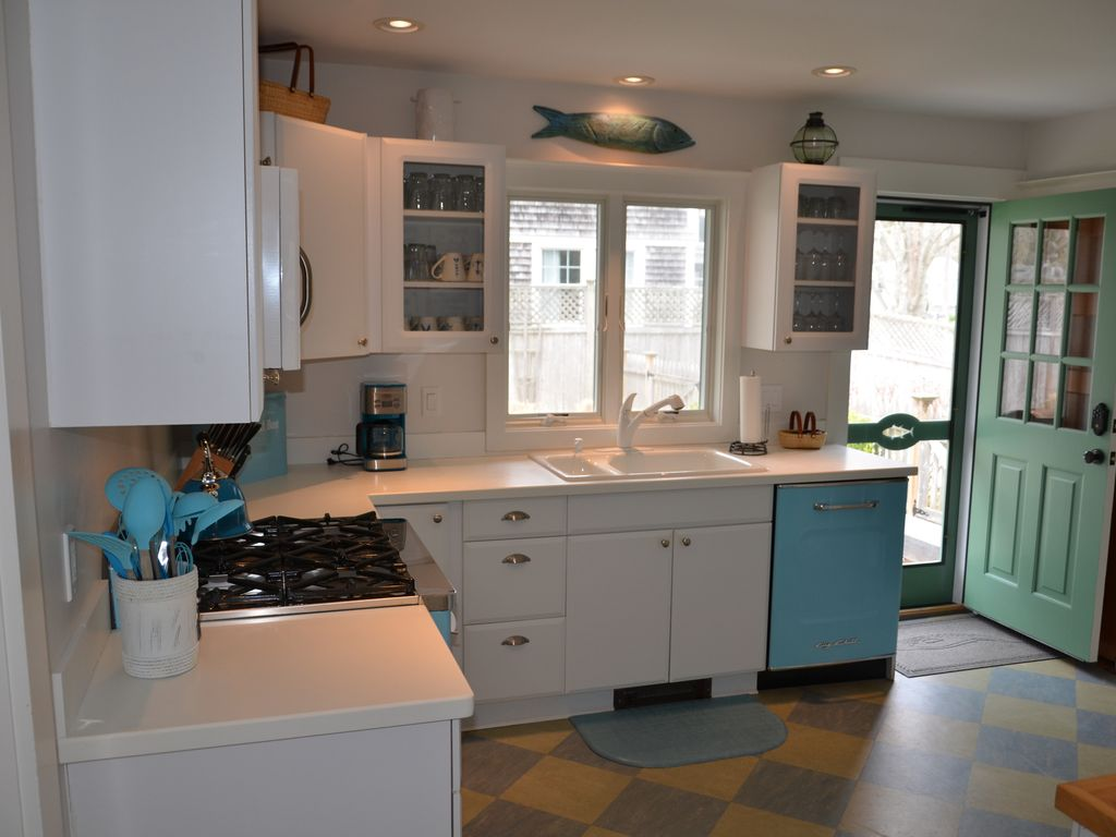 Sunny and spacious kitchen with coastal feel and colors.