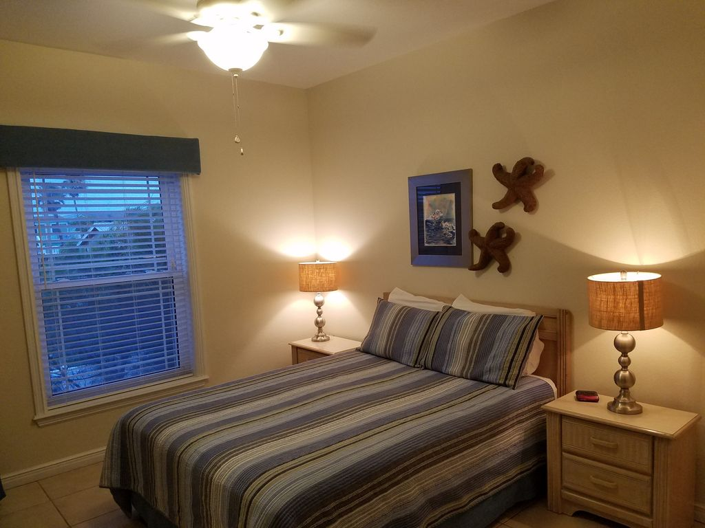 Queen Bedroom #5 has private access to full hall bath with shower.
