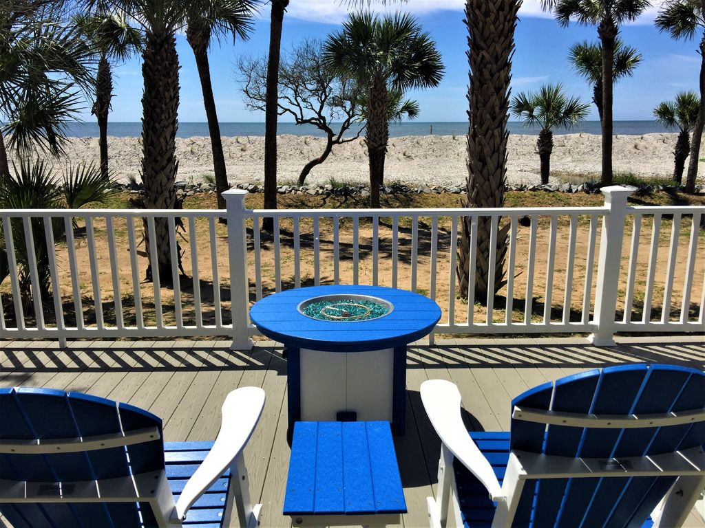 Relax by the fire pit with a view of the ocean!