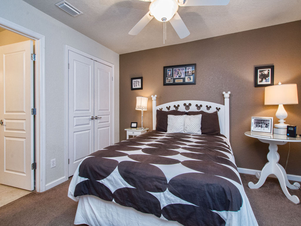 Master bedroom number two features a queen sized bed and private bathroom.
