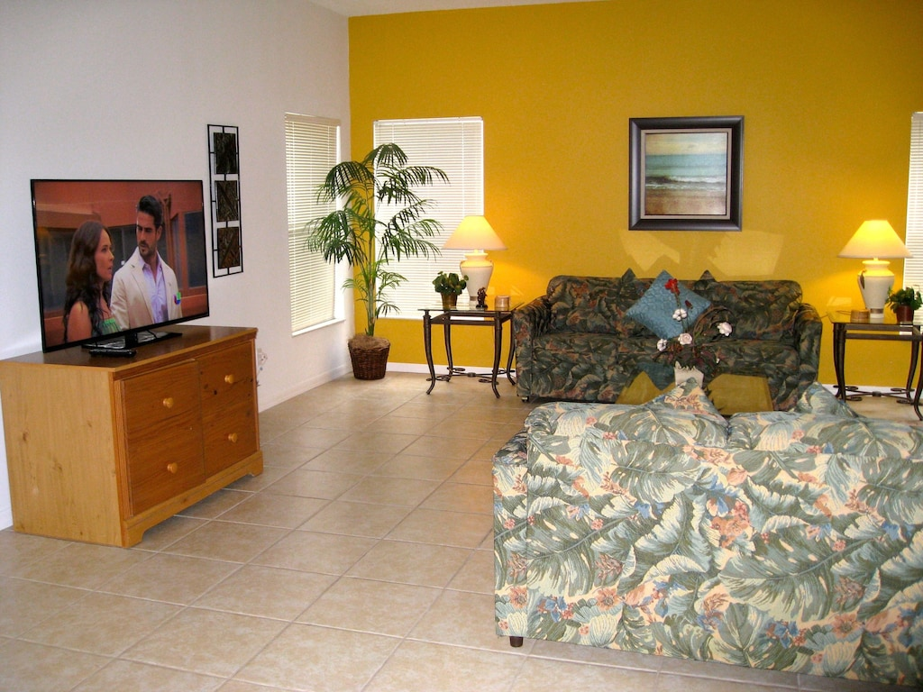 Huge family room with large TV and enough seats for the entire family