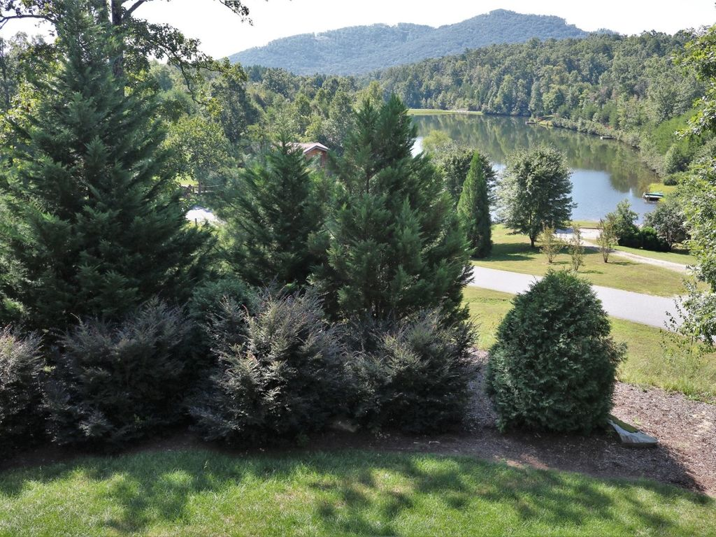 Aside from the great lake and mountain view, notice the level grassy yard - this home offers a lot