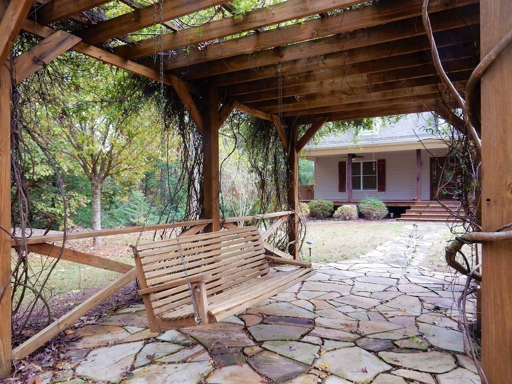 Covered trellis with swing bench
