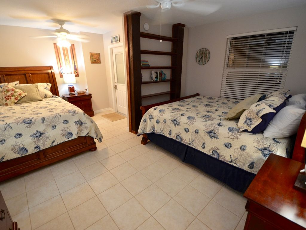 King bed and full bed in one bedroom but still plenty of space. Full dresser