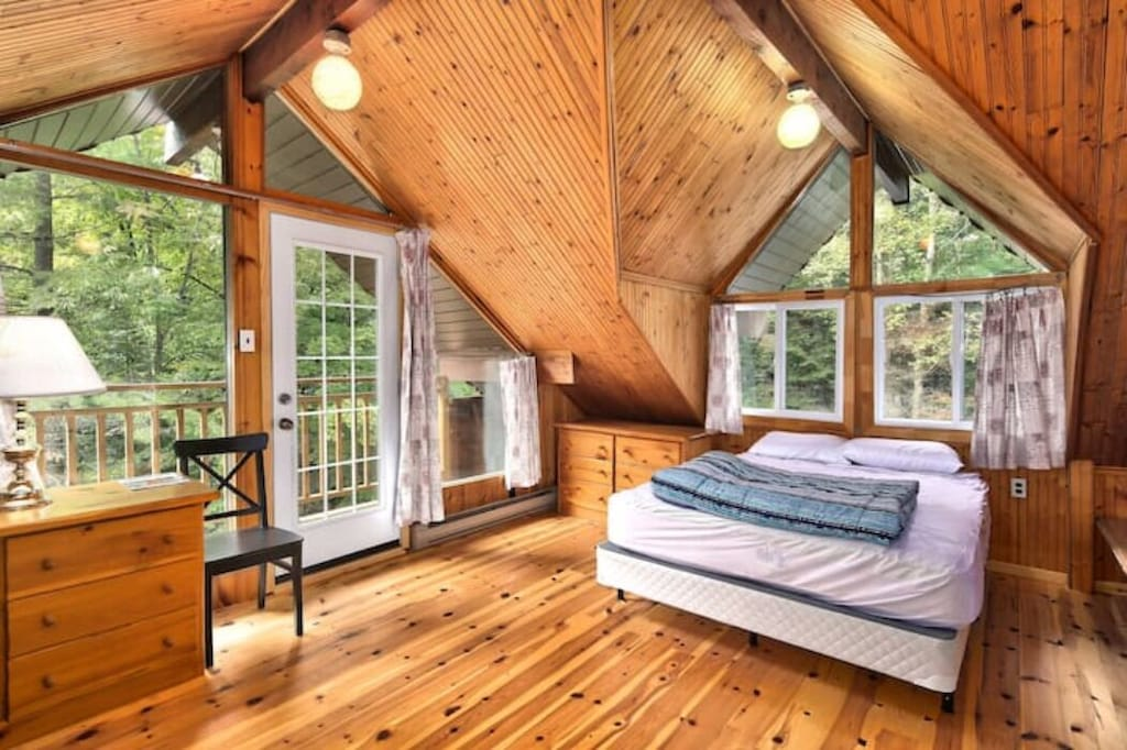 Sprawl out in your very own loft style wood bedroom with high vaulted ceilings