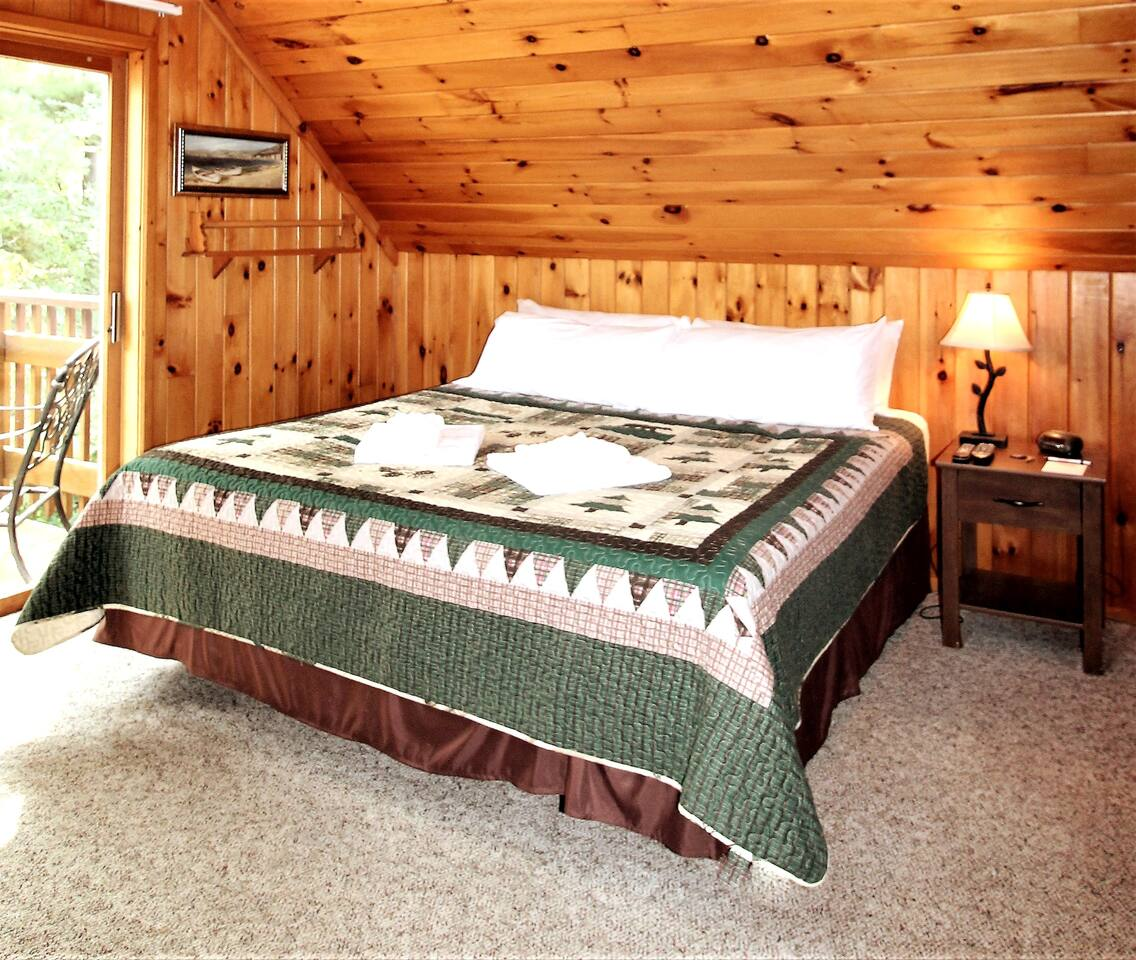 Bedroom #1 - King bed upstairs with private balcony overlooking the lake.