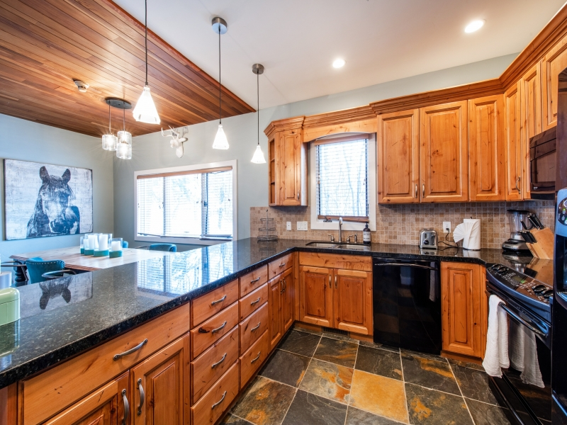 Large well stocked kitchen, with dining area adjacent.