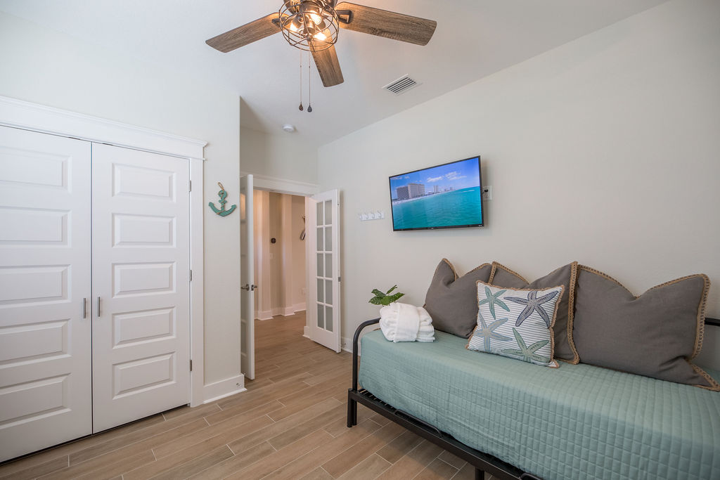 Smart TV and full closet with luggage rack