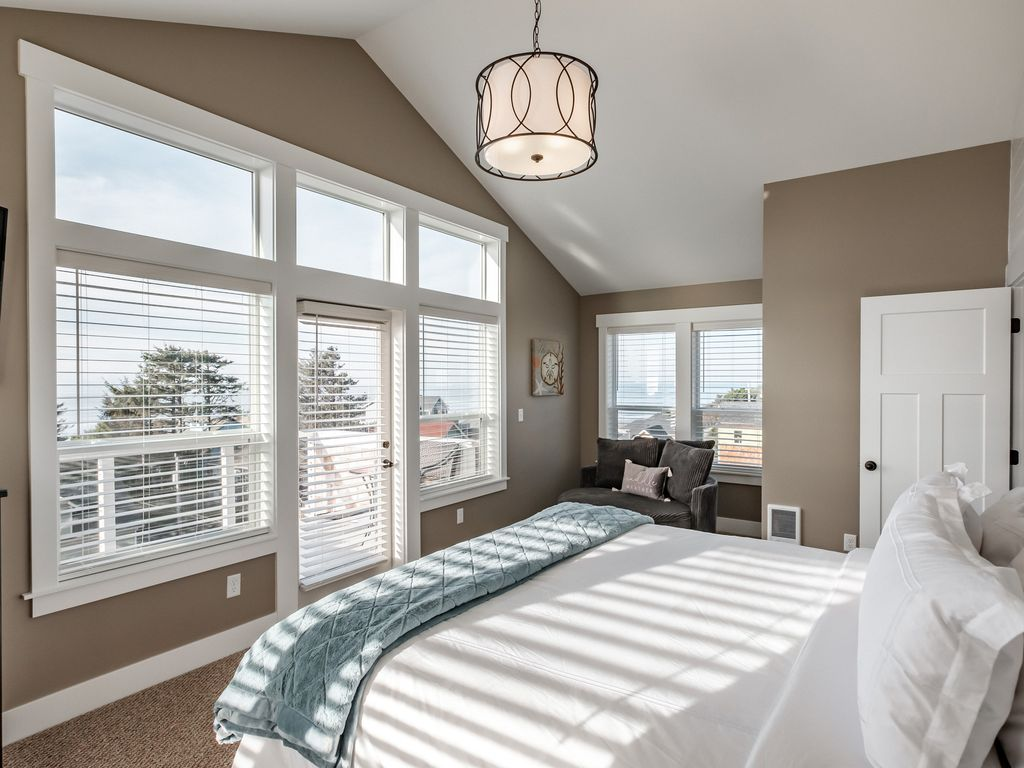 Upper master king suite with ocean views and private balcony.