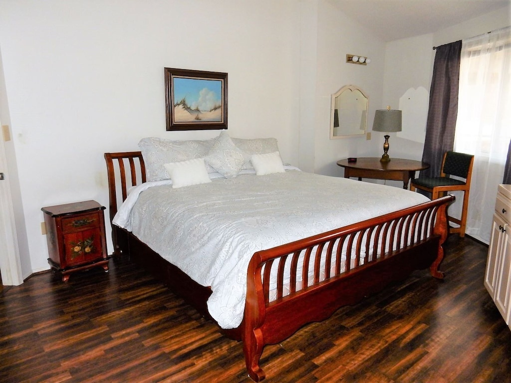 Upper level master bedroom with king bed and private bath