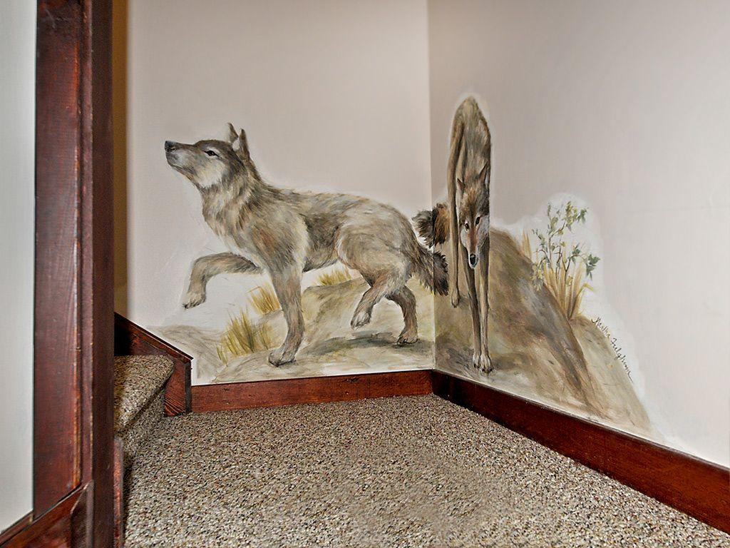 Hand painted mural on stair landing to 2d floor.