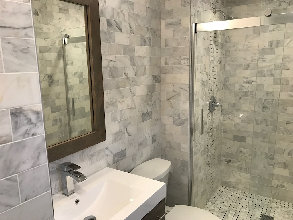 Upgraded bathrooms throughout unit w/ floor to ceiling tile.