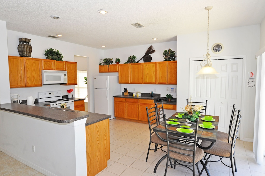 big open kitchen and breakfast area with direct access to the pool area