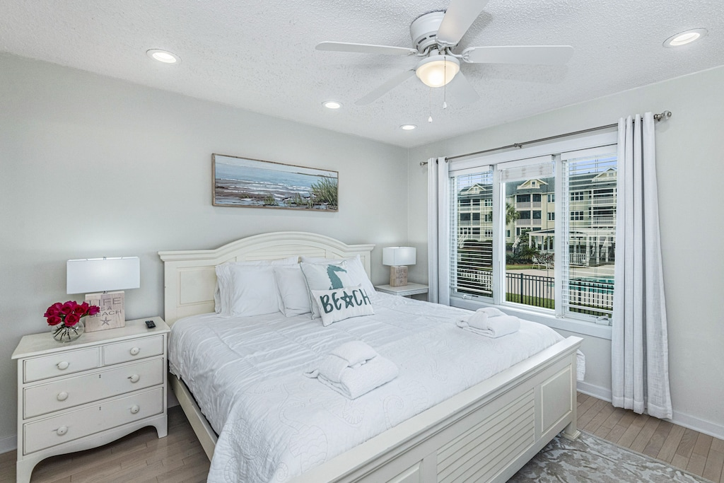 King size master bedroom with pool view
