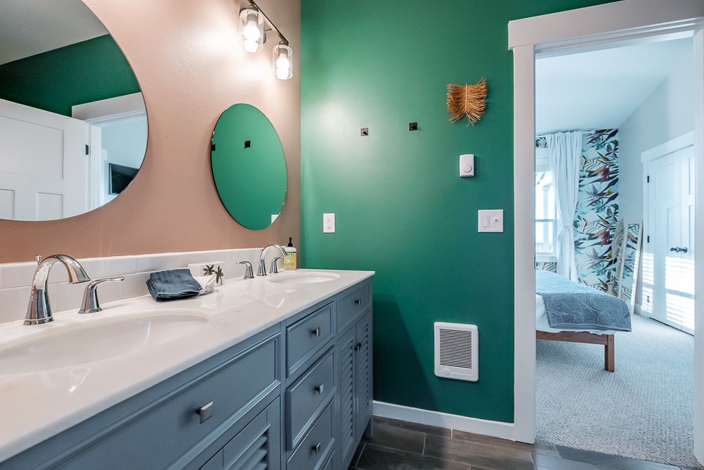 Double vanity stations are a treat in this spacious bathroom.
