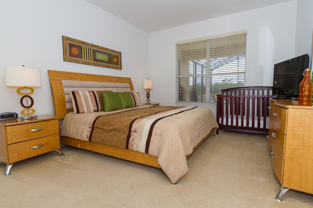 Downstairs King master bedroom with crib