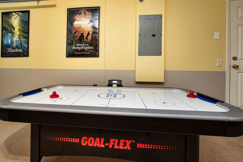 Featuring an air hockey table...