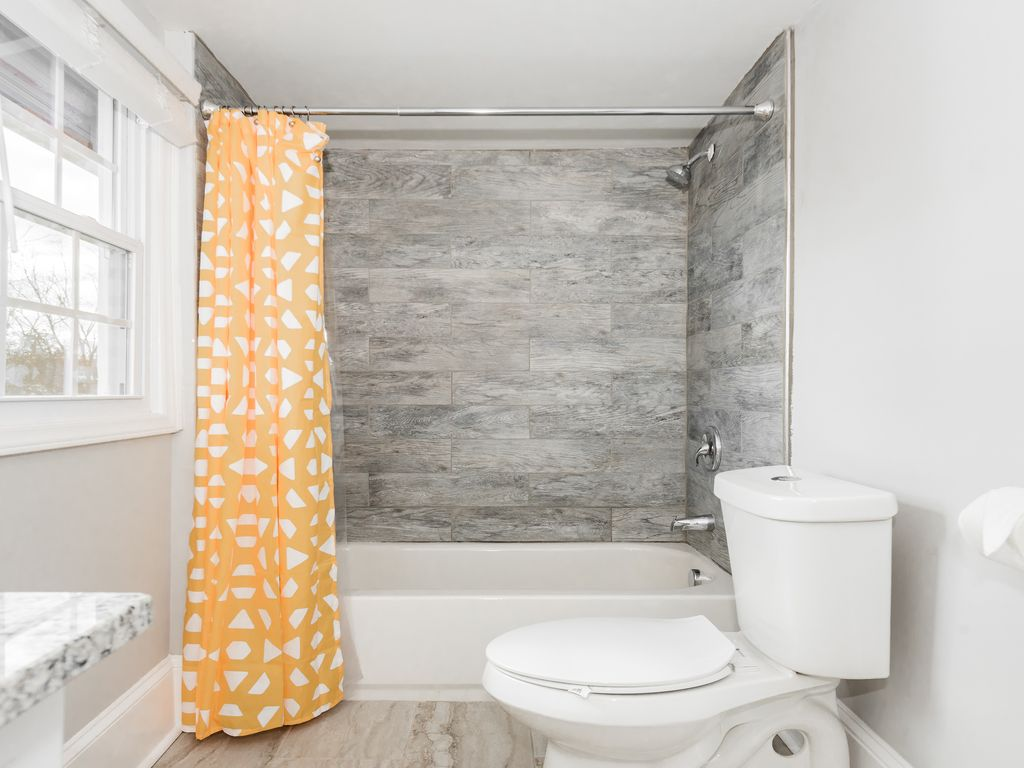 Full tub/shower, toilet, sink with plenty of counter space. Hairdryer included.