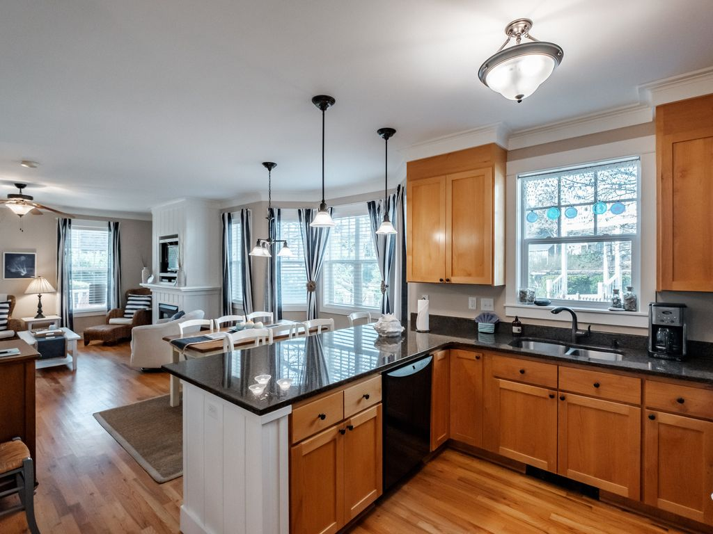 Spacious main level includes open flowing living, dining, and kitchen.