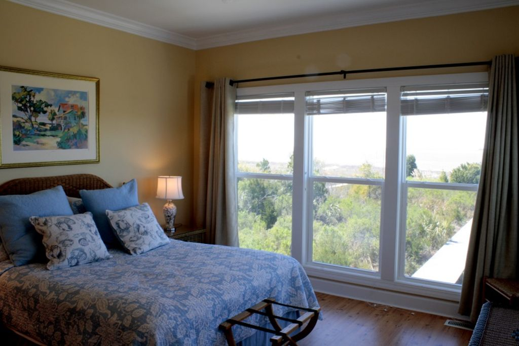 Master Bedroom on main level offer panoramic views of the sound.