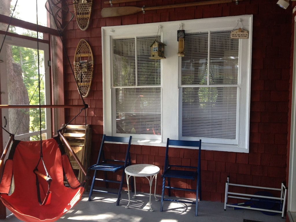 Screened in porch with the popular sky chair!  Make sure you grab it first!