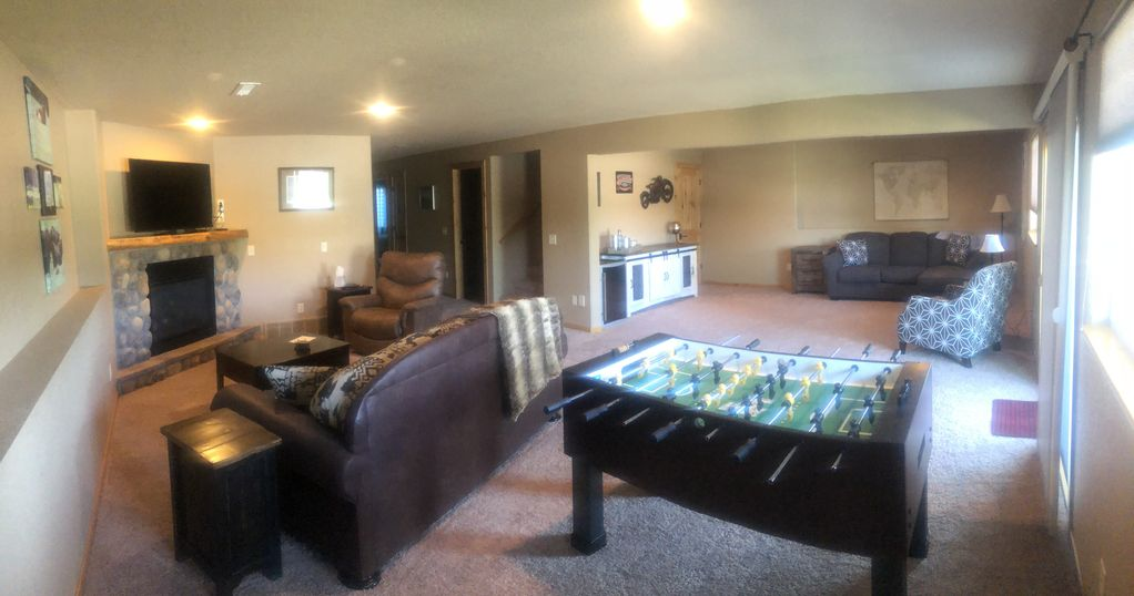 Downstairs living room with foosball table.